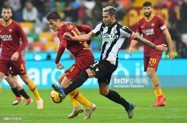 Patrik Schick of AS Roma competes for the ball with Valon Behrami of Udinese Calcio during the Serie A match between Udinese and AS Roma at Stadio...