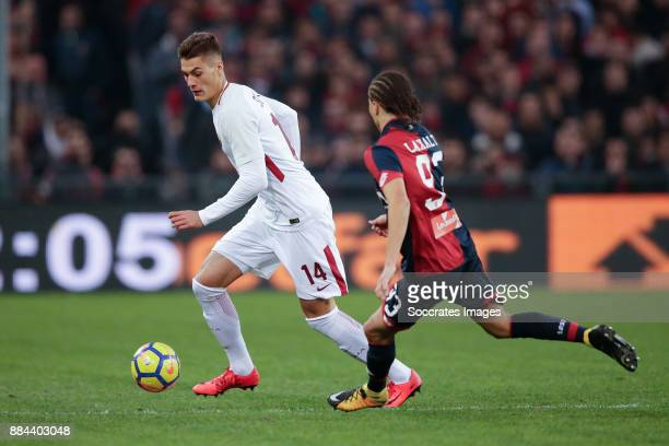 Patrik Schick of AS Roma Diego Laxalt of Genua during the Italian Serie A match between Genoa v AS Roma at the Stadio Luigi Ferraris on November 26...