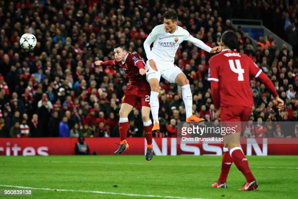 Patrik Schick of AS Roma heads towards goal as Andrew Robertson of Liverpool challenges him during the UEFA Champions League Semi Final First Leg...