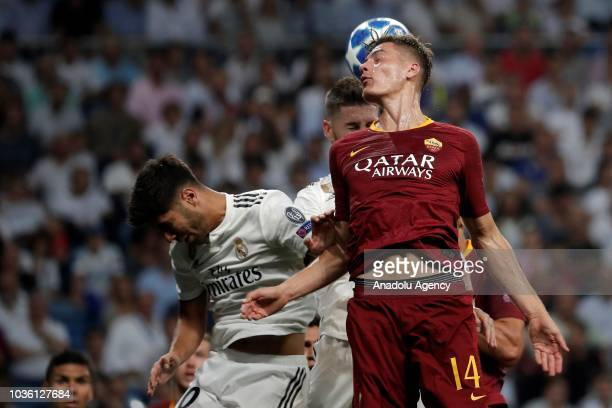 Patrik Schick of AS Roma in action against Marco Asensio of Real Madrid during UEFA Champions League Group G soccer match between Real Madrid and AS...