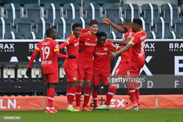 Patrik Schick of Bayer 04 Leverkusen celebrates with teammates after scoring his team's first goal during the Bundesliga match between Borussia...