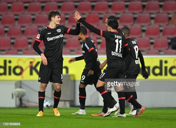 Patrik Schick of Bayer Leverkusen celebrates with Nadiem Amiri and teammates after scoring their team's third goal during the Bundesliga match...