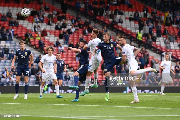 Patrik Schick of Czech Republic scores their side's first goal whilst under pressure from Liam Cooper of Scotland during the UEFA Euro 2020...