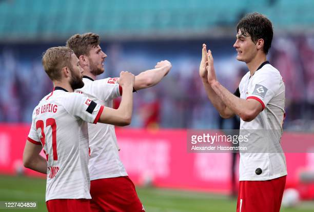 Patrik Schick of Leipzig celebrate with Konrad Laimer and Timo Werner during the Bundesliga match between RB Leipzig and Hertha BSC at Red Bull Arena...