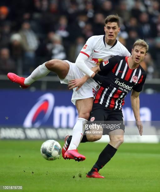 Patrik Schick of Leipzig is challenged by Martin Hinteregger of Frankfurt during the Bundesliga match between Eintracht Frankfurt and RB Leipzig at...