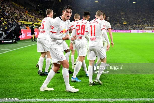 Patrik Schick of RB Leipzig celebrates after scoring his team's third goal during the Bundesliga match between Borussia Dortmund and RB Leipzig at...