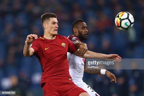 Patrik Schick of Roma and Nicolas Nkoulou of Torino during the Italian Serie A football match between AS Roma and FC Torino at the Olympic Stadium in...