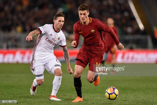 Patrik Schick of Roma is challenged by Lucas Biglia of Milan during the Serie A match between Roma and AC Milan at Olympic Stadium Roma Italy on 25...