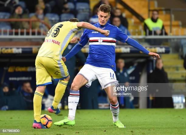 Patrik Schick of Sampdoria and Andrea Coda of Pescara during the Serie A match between UC Sampdoria and Pescara Calcio at Stadio Luigi Ferraris on...