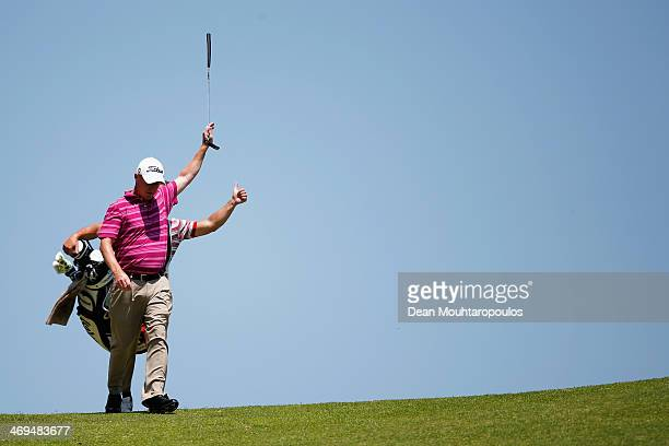 Patrik Sjoland of Sweden holds his club in the air on the 5th hole during Day 3 of the Africa Open at East London Golf Club on February 15, 2014 in...