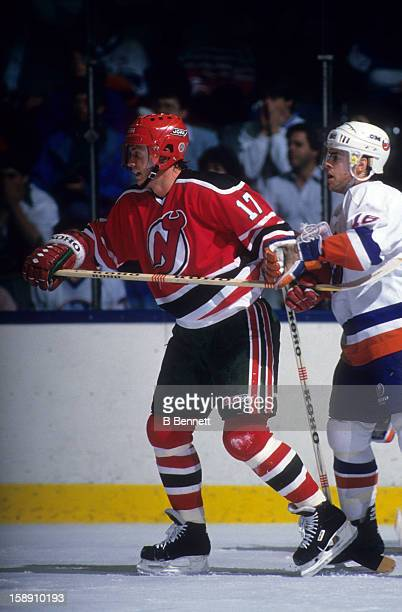 Patrik Sundstrom of the New Jersey Devils battles with Pat Lafontaine of the New York Islanders on October 24 1987 at the Nassau Coliseum in...