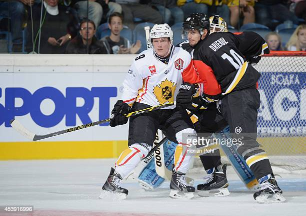 Patrik Zackrisson of Skelleftea AIK and Andreas Driendl of Krefeld Pinguine struggle for position in front of net during the Champions Hockey League...