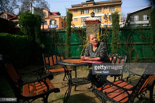 Patrina Churm now working as manager in a hotel poses for a picture on March 29 2011 in Srinagar the summer capital of Indian administered Kashmir...