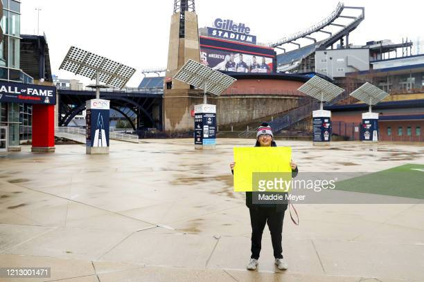 Patriot fan Kosta Agganis of Saugus MA stands with a sign thanking former New England Patriots quarterback Tom Brady outside of Gillette Stadium on...