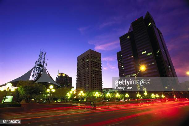 patriot square at dusk - vehicle light stock pictures, royalty-free photos & images
