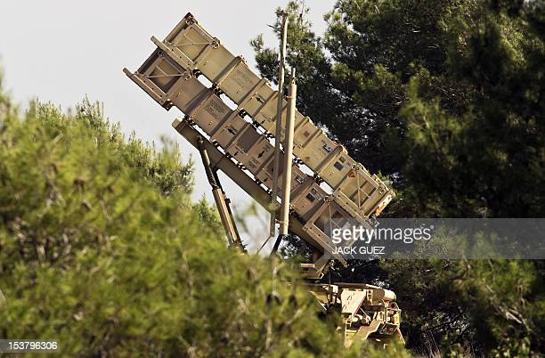 A Patriot surfacetoair missile battery is deployed in Mount Carmel in the northern coastal city of Haifa on October 9 two days after an unmanned...
