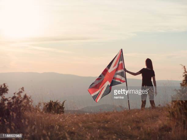 patriot with british flag on top of a mountain - memorial event stock pictures, royalty-free photos & images