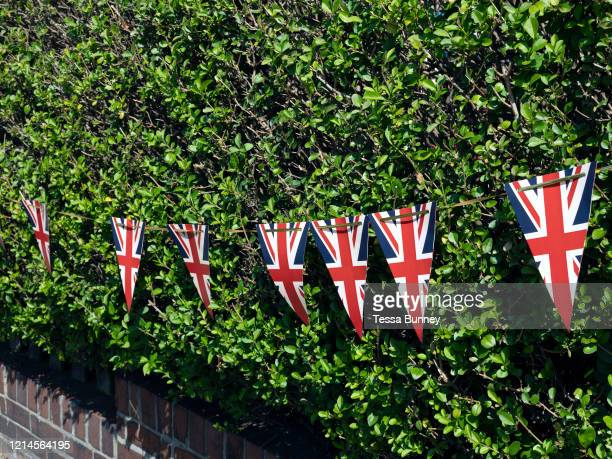 Patriotic bunting on display on a hedge outside a garden on 7 May 2020 in SaltburnbytheSea Cleveland United Kingdom VE Day or 'Victory in Europe Day'...