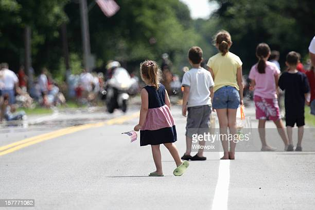 patriotic children waiting for july 4th parade - parade stock pictures, royalty-free photos & images