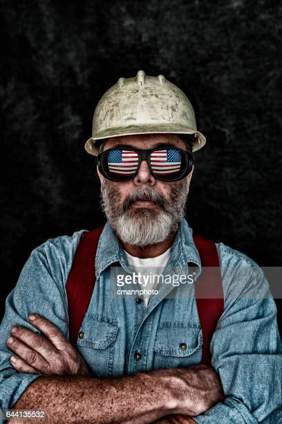 Patriotic construction worker with US Flag reflection in sunglasses