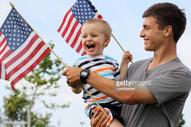 patriotic dad and son - independence day stock pictures, royalty-free photos & images