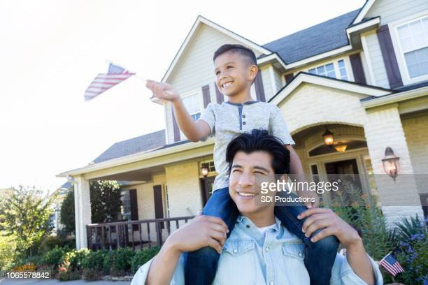 patriotic father and son - patriotic stock pictures, royalty-free photos & images