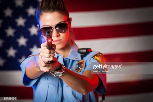 Patriotic Female Police Officer Aiming Handgun