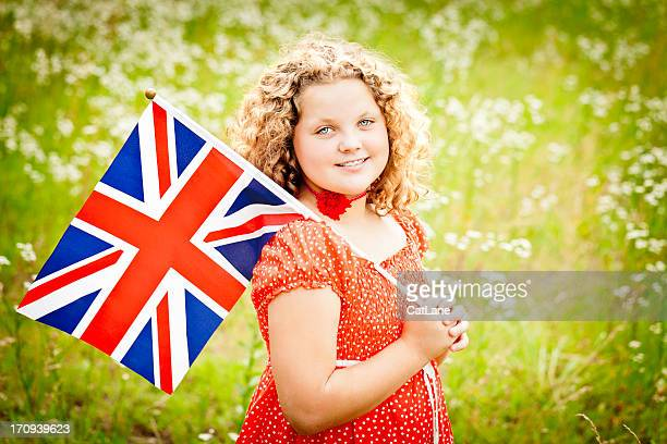 Patriotic Girl with Union Jack in Field of Wildflowers