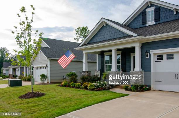patriotic homes and neighborhoods and the celebration of independence day - labor day stock pictures, royalty-free photos & images