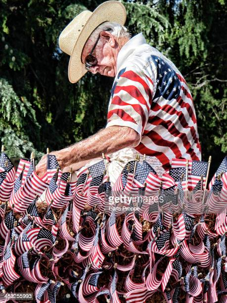 CONTENT] A patriotic man decorating a float for the Fourth of July parade in Newhall California