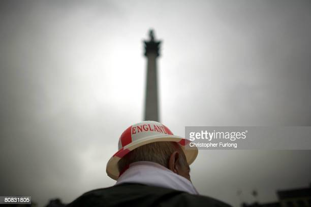 Patriotic pensioner Jim Diper braves the rain to don his plastic England bowler hat and join the festivities below Nelson's Column celebrating Saint...
