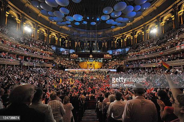 Patriotic revellers wave flags at the Royal Albert Hall in west London on September 10 2011 during the last night of the Proms The final evening of...