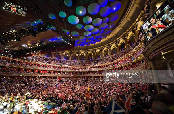 Patriotic revellers wave flags at the Royal Albert Hall in west London, on September 12 during the last night of the Proms. The final evening of the...