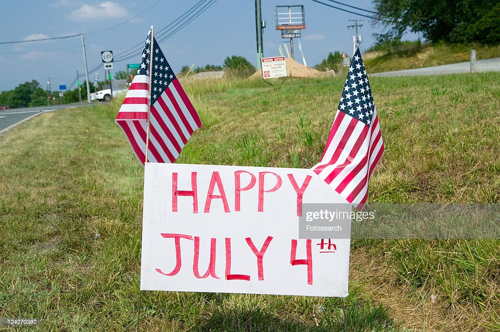 Patriotic roadside sign reading Happy July 4 : Stock Photo