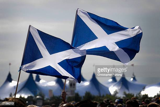 Patriotic Scottish music lovers get into the party mood during The T In The Park Festival on July 12 2003 at Balado near Kinross Scotland