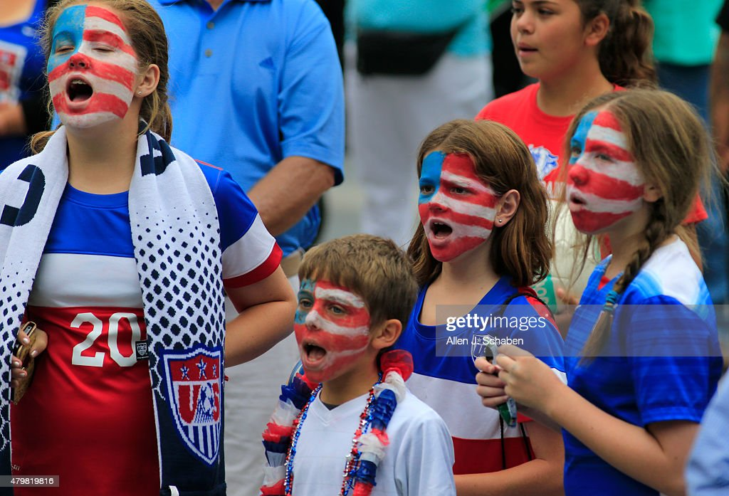 Patriotic soccer fans cheer as the 2015 United States Women's National Soccer Team takes the stage after winning the FIFA Women's World Cup at a free, public championship celebration at L.A. Live's Microsoft Square in Los Angeles, Calif., on July 7, 2015.