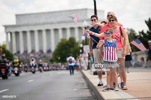 Patriotic spectators line Memorial Bridge to welcome riders into Washington D.C.