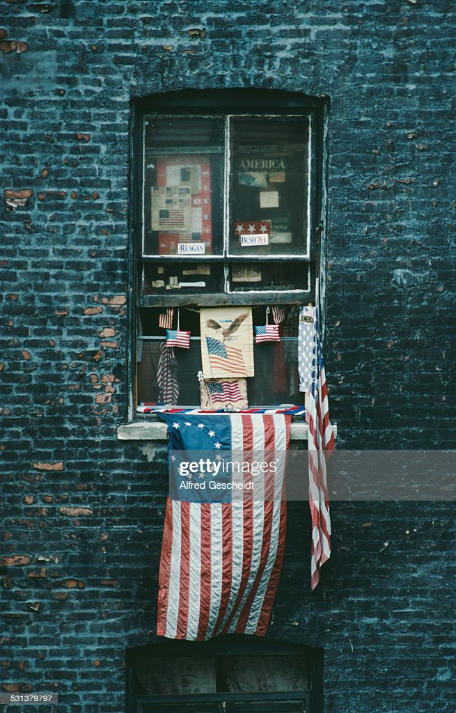 A patriotic window display, with a Betsy Ross flag and Republican campaign stickers, New York City, 1988.