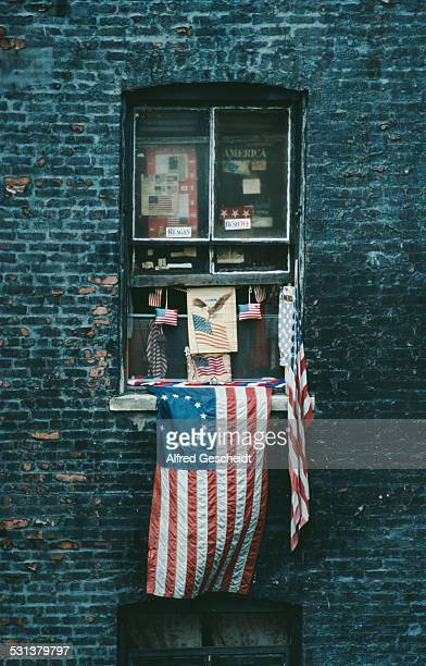A patriotic window display with a Betsy Ross flag and Republican campaign stickers New York City 1988
