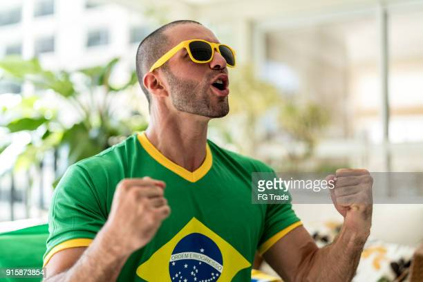 patriotism and celebration of a brazilian young fan - international soccer event stock pictures, royalty-free photos & images