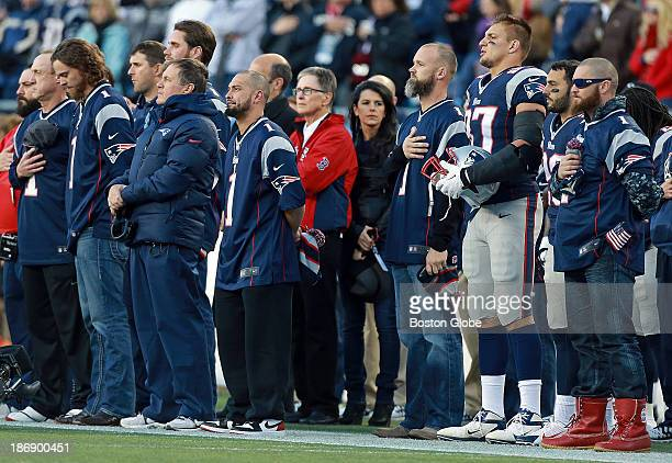 Patriots and Red Sox line up together during the singing of the national anthem before the game Clay Buchholz Bill Belichick Shane Victorino John...