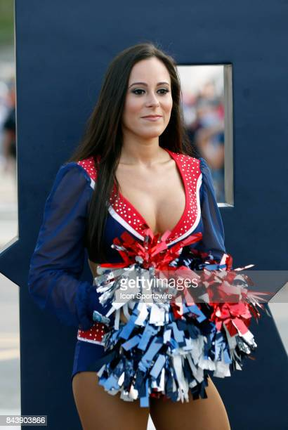 Patriots cheerleader greets fans before an NFL preseason game between the New England Patriots and the New York Giants on August 31 2017 at Gillette...