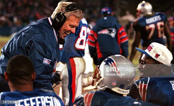 Patriots coach Bill Parcells breaks into a rare sidelines grin as he celebrates with Shawn Jefferson Terry Glenn and Keith Byars on the bench in the...