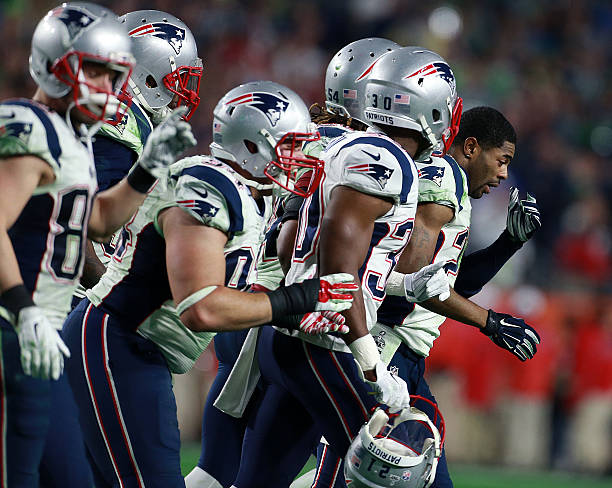 37c662edb Patriots cornerback Malcolm Butler (without helmet) looks stunned as he  leads the defense off