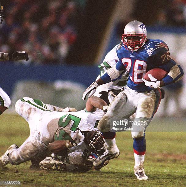 Patriots Curtis Martin breaks from a tackle by Jets Marvin Jones