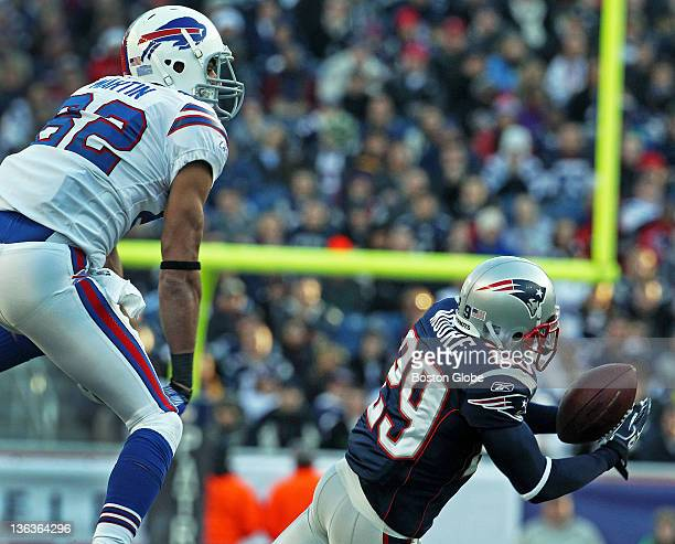 Patriots DB Sterling Moore intercepts a third quarter pass intended for Bills WR Ruvell Martin left the turnover gave New England the ball at the...