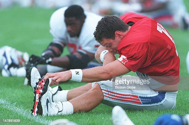 Patriots Drew Bledsoe stretching out and warming up during today's practice