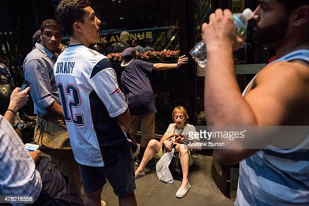 Patriots fans and members of the media wait for Tom Brady to leave NFL headquarters on June 23 2015 in New York City Brady was appealing the four...