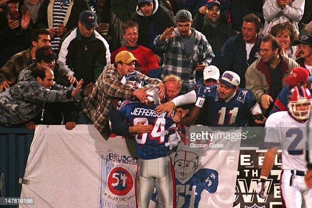 Patriots fans mob wide receiver Shawn Jefferson after he caught a long pass from Drew Bledsoe and went out of bounds just short of the goal line It...