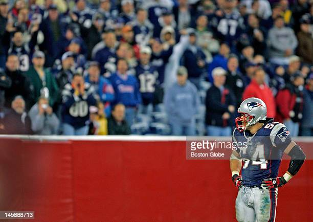 Patriots fans salute linebacker Tedy Bruschi after he made a diving tackling effort in the end zone on his coverage play on Josh Miller's last kick...